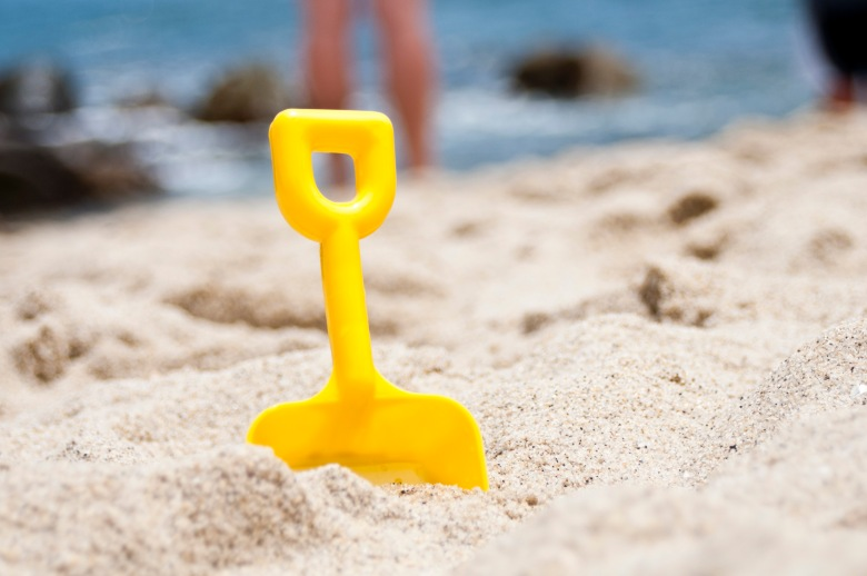 Spade in sand on the beach