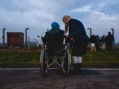 person in wheelchair with friend