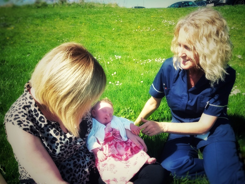 Michelle with new mum Sian and her baby out in the sunshine.