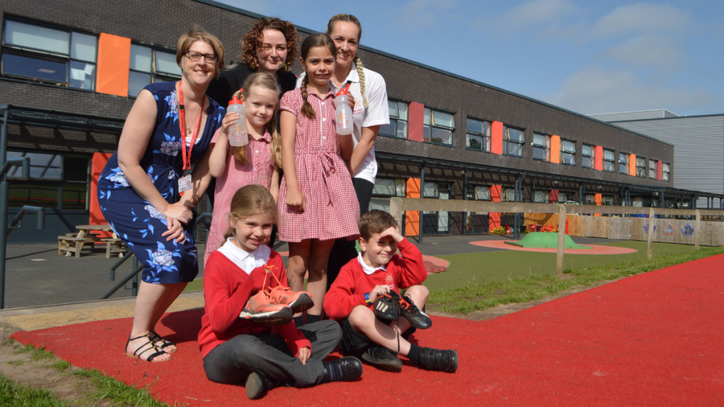 Pupils and teachers from Grange Park Primary School on their Daily Mile track